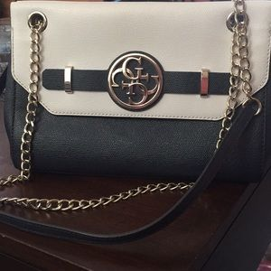 White and navy Guess clutch worn once still new